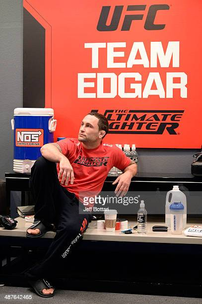Coach Frankie Edgar sits in the locker room before his fighter Todd Monaghan faces Team Penn fighter Daniel Spohn in their preliminary fight during...