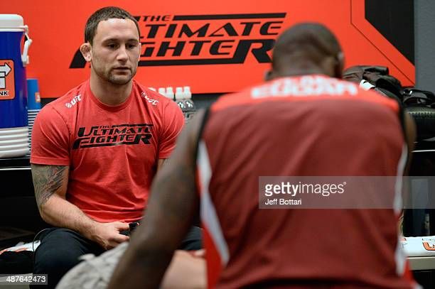 Coach Frankie Edgar speaks with his fighter Todd Monaghan before he faces Team Penn fighter Daniel Spohn in their preliminary fight during filming of...