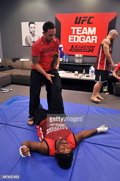 Coach Frankie Edgar stretches his fighter Todd Monaghan before he faces Team Penn fighter Daniel Spohn in their preliminary fight during filming of...