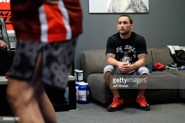 Coach Frankie Edgar watches as team Edgar fighter Dhiego Lima warms up before facing team Penn fighter Tim Williams in their preliminary fight during...