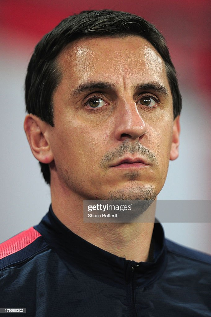 Coach Gary Neville of England looks on ahead of the FIFA 2014 World Cup Qualifying Group H match between England and Moldova at Wembley Stadium on September 6, 2013 in London, England.