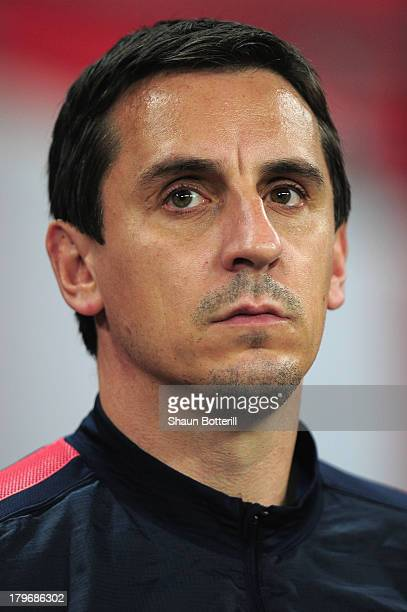 Coach Gary Neville of England looks on ahead of the FIFA 2014 World Cup Qualifying Group H match between England and Moldova at Wembley Stadium on...