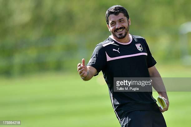 Coach Gennaro Gattuso smiles during a US Citta di Palermo preseason training session at Sportzentrum on July 12 2013 in Sankt Lambrecht near St Veit...