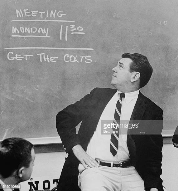 Coach George Allen looks over his shoulder at the blackboard which tells the story in the Ram's dressing room The Rams capitalized on a blocked kick...