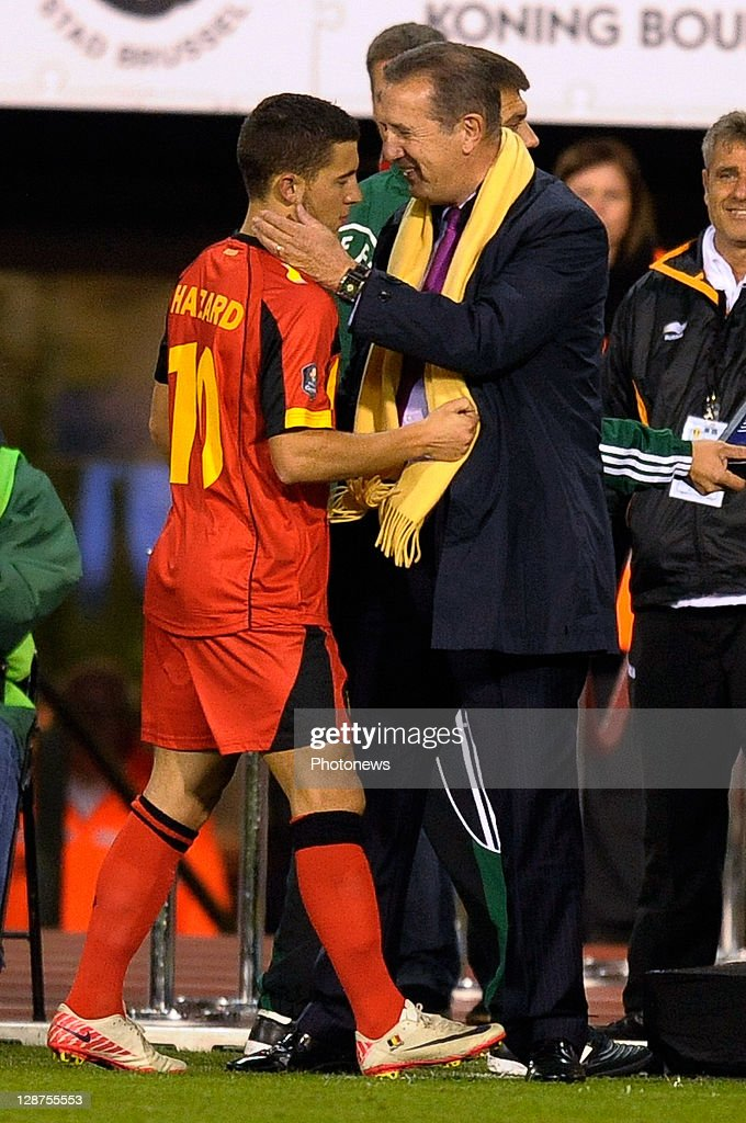 Coach George Leekens of Belgium congratulates goalscorer Eden Hazard during the UEFA EURO 2012 Group A qualifying match between Belgium and Kazakhstan at King Baudouin Stadium on October 7, 2011 in Brussels, Belgium.