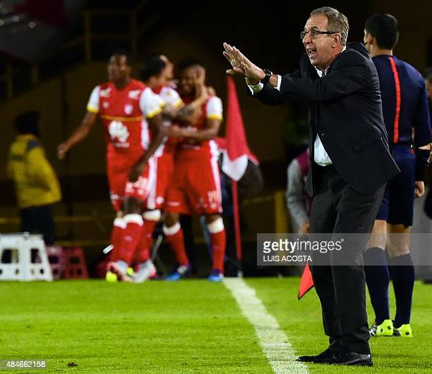Coach Gerardo Pelusso of Colombia's Santa Fe, gives instructions to his players during their 2015 Sudamericana Cup football match against Ecuador's...