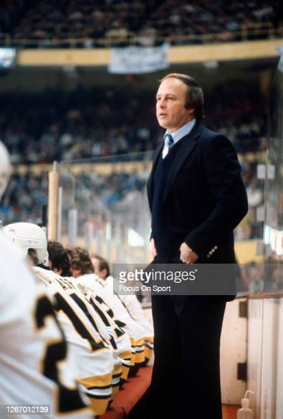 Coach Gerry Cheevers of the Boston Bruins looks on from the bench during an NHL Hockey game circa 1981 at the Boston Garden in Boston, Massachusetts....