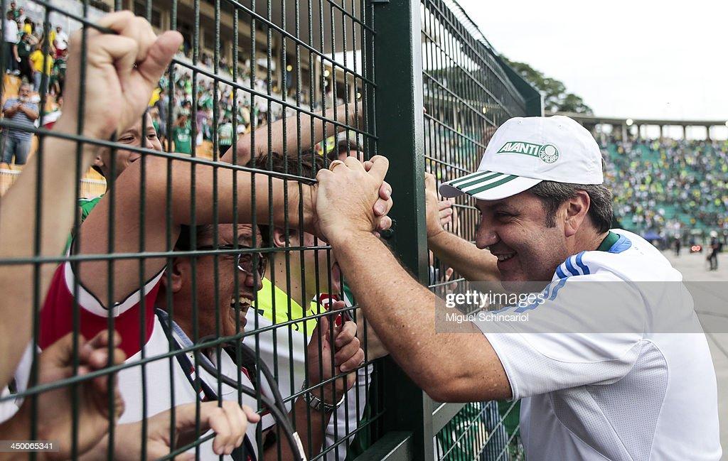Coach Gilson Kleina of Palmeiras celebrates after the match between Palmeiras and Boa Esporte for the Brazilian Championship Series B 2013 at Pacaembu Stadium on November 16, 2013 in Sao Paulo, Brazil.