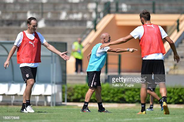 Coach Giuseppe Sannino issues instructions as Milan Milanovic and Steve Von Bergen react on during a US Citta di Palermo training session at Carmelo...