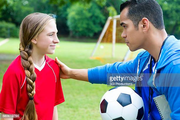 Coach gives teen soccer player pep talk