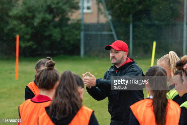 coach giving encouragement - manager stock pictures, royalty-free photos & images