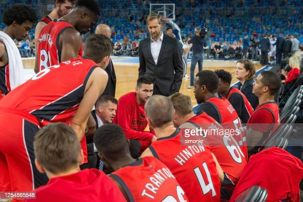 coach giving instructions to basketball team - match sport stock pictures, royalty-free photos & images