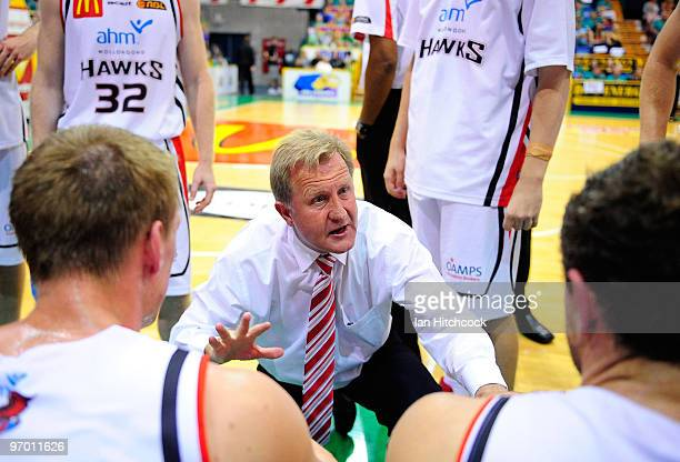 Coach Gordie McLeod of the Hawks talks to his players during a timeout during game two of the NBL semi final series between the Townsville Crocodiles...
