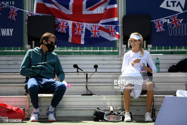Coach Greg Rusedski speaks with Katie Boulter of Union Jack in her singles match against Johanna Konta of British Bulldogs during day two of the St...