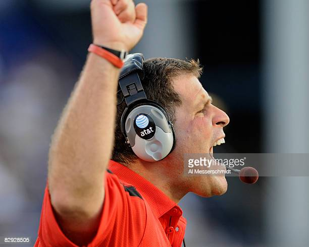 Coach Greg Schiano of the Rutgers Scarlet Knights directs play against the Navy Midshipmen at Jack Stephens Field at NavyMarine Corps Memorial...