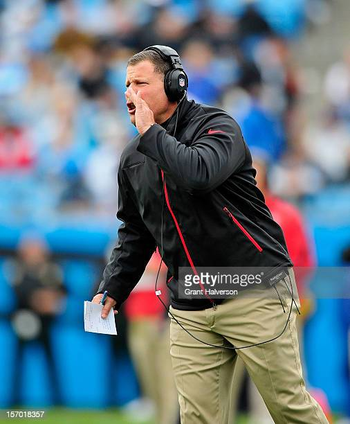 Coach Greg Schiano of the Tampa Bay Buccaneers calls instructions to his team during a game against the Carolina Panthers at Bank of America Stadium...