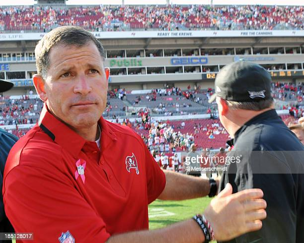 Coach Greg Schiano of the Tampa Bay Buccaneers leaves the field for play against the Philadelphia Eagles October 13 2013 at Raymond James Stadium in...