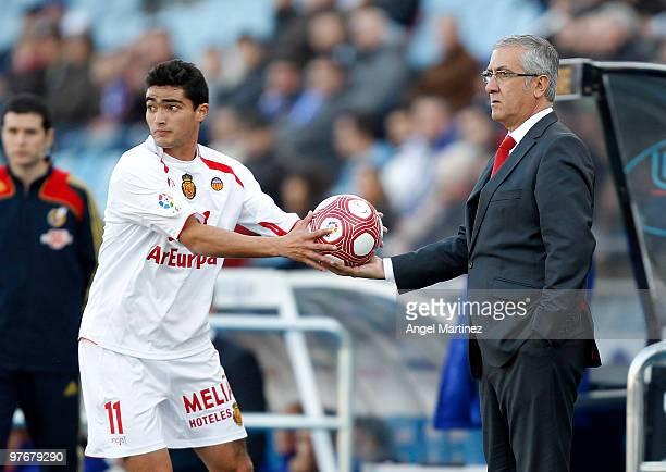 Coach Gregorio Manzano of Mallorca gives the ball to his player Gonzalo Castro during the La Liga match between Getafe and Mallorca at Coliseum...