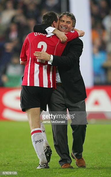 Coach Guus Hiddink of PSV celebrates victory over Lyon during the UEFA Champions League quarter final, second leg match between PSV Eindhoven and...