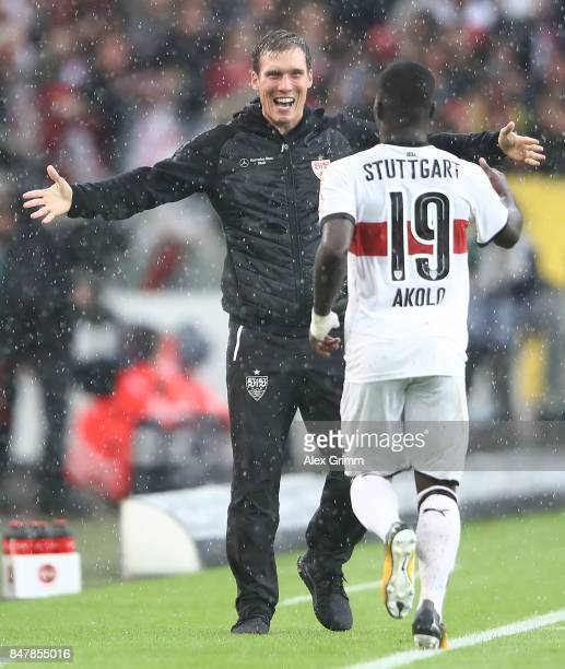 Coach Hannes Wolf of Stuttgart celebrates with Chadrac Akolo of Stuttgart after he scored his teams first goal to make it 10 during the Bundesliga...