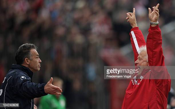 Coach HansGuenter Bruns and second coach Oliver Adler of Oberhausen celebrate after the second goal during the Second Bundesliga match between RW...