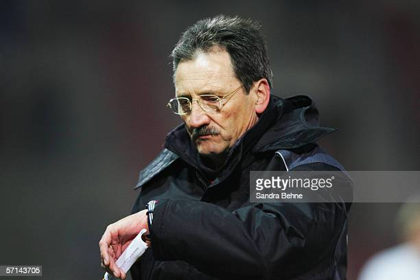 Coach Harry Deutinger of Unterhaching looks at his watch during the Second Bundesliga match between Spvgg Unterhaching and SC Freiburg at the...