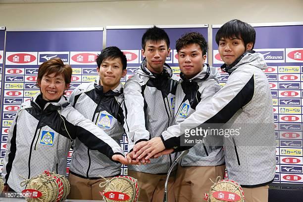 Coach Hatomi Nagaoka Kosuke Morozumi Tetsuro Shimizu Tsuyoshi Yamaguchi and Yusuke Morozumi of SC Karuizawa pose for photos after winning against...