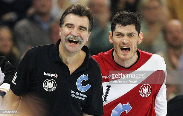 Coach Heiner Brand and Henning Fritz of Germany look on during the Men's Handball World Championship Group I game between Slovenia and Germany at the...