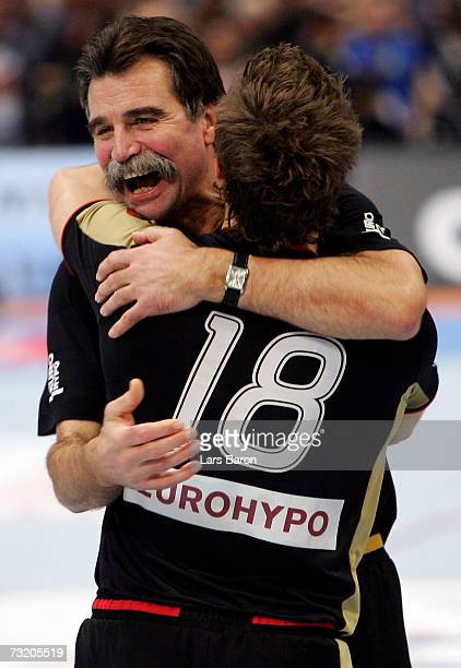 Coach Heiner Brand celebrates with Michael Kraus after winning the IHF World Championship final game between Germany and Poland at the Cologne Arena...