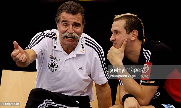 Coach Heiner Brand of Germany gives advise to Pascale Hens during the Euro 2012 qualifier match between Germany and Lithuanie on June 12, 2011 in...