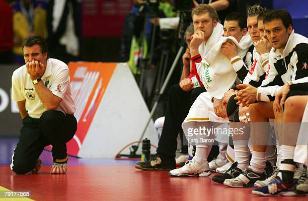 Coach Heiner Brand of Germany looks dejected next to his players during the Men's Handball European Championship main round Group II match between...
