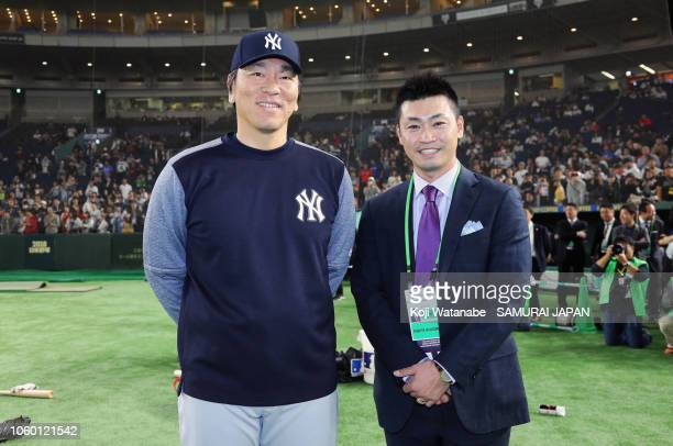 Coach Hideki Matsui of the New York Yankees and Tokyo Yakult Swallows player Norichika Aoki pose for photographs prior to the game three of Japan and...