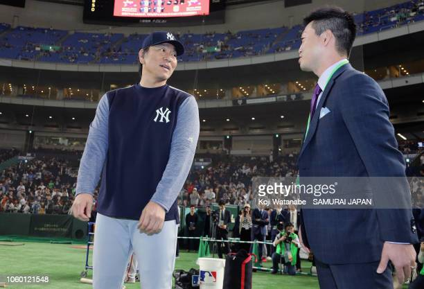 Coach Hideki Matsui of the New York Yankees is greeted by Tokyo Yakult Swallows player Norichika Aoki prior to the game three of Japan and MLB All...