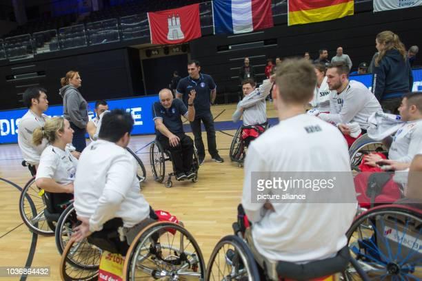 Coach Holger Glinicki of Hamburg sits with the team after the EuroLeague wheelchair basketball qualifier match between BG Basket Hamburg and Beit...