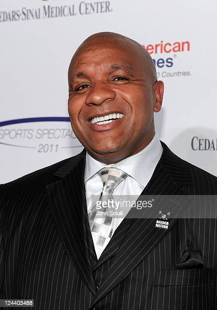 NFL coach Hue Jackson arrives at the 2011 Cedars Sinai Sports Spectacular at Hyatt Regency Century Plaza on May 22 2011 in Beverly Hills California