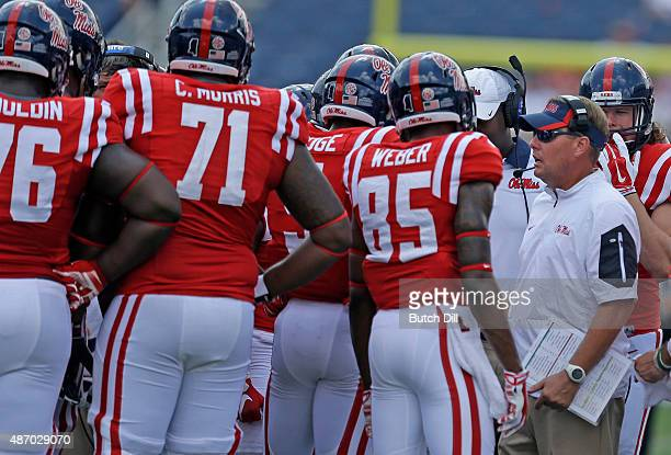 Coach Hugh Freeze of the Mississippi Rebels talks to players during the second half of a NCAA college football game against the Tennessee Martin...