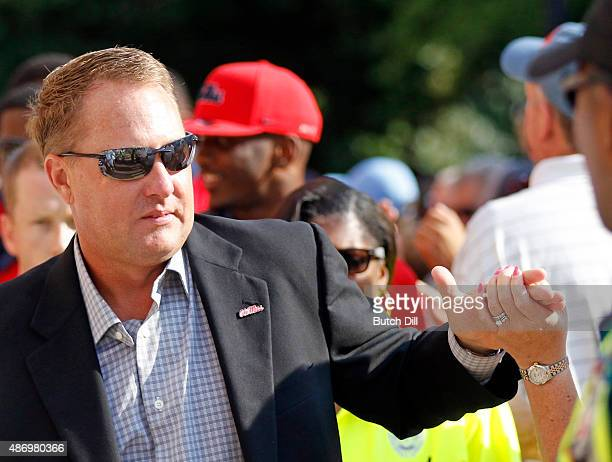 Coach Hugh Freeze of the Mississippi Rebels walks through the Grove before a NCAA college football game against the Tennessee Martin Skyhawks at...
