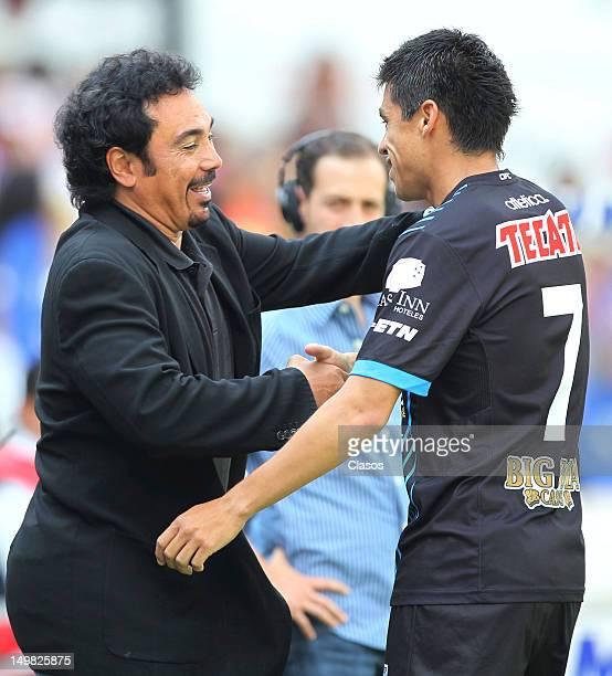 Coach Hugo Sanchez of Pachuca celebrates with a player during a match between Queretaro and Pachuca as part of the Liga Mx at La Corregidora Stadium...