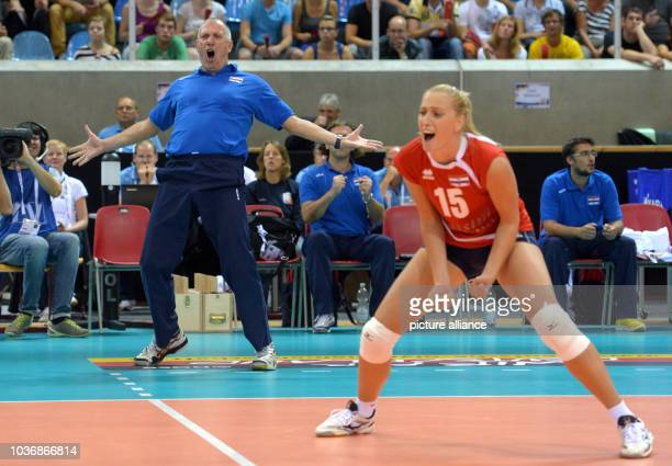 Coach Igor Lovrinov and Bernarda Brcic of Croatia celebrate during the women's CEV Volleyball European Championship Group C match between Belarus and...