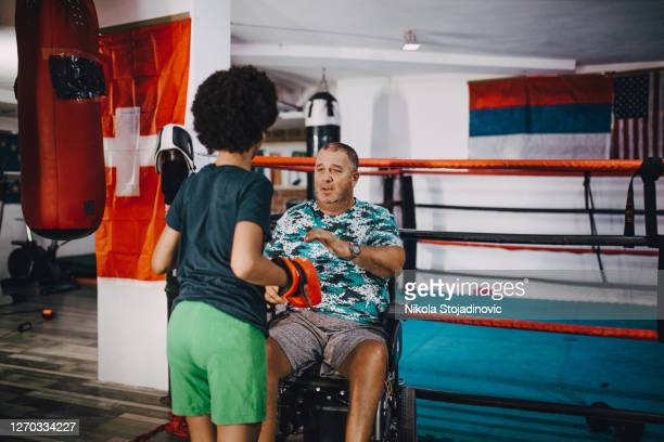 coach in a wheelchair and boxing - strike industrial action stock pictures, royalty-free photos & images