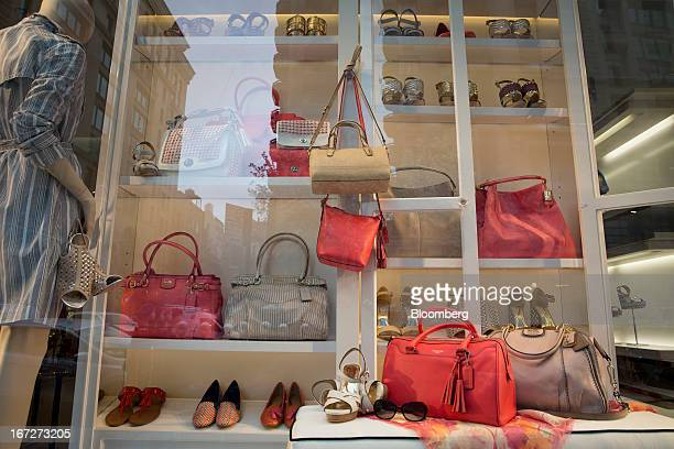 4ef49bf465 Coach Inc handbags are displayed in a shop window at one of the company's  locations in