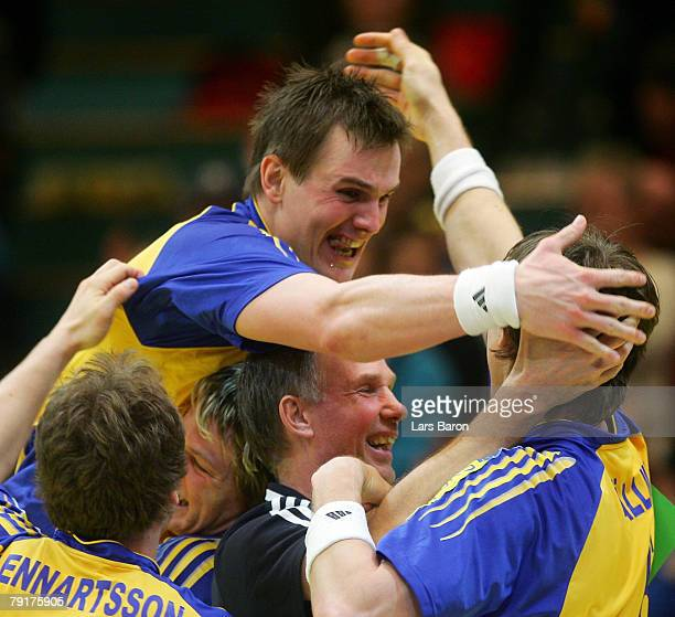 Coach Ingemar Linnell of Sweden celebrates with his players after winning the Men's Handball European Championship main round Group II match between...