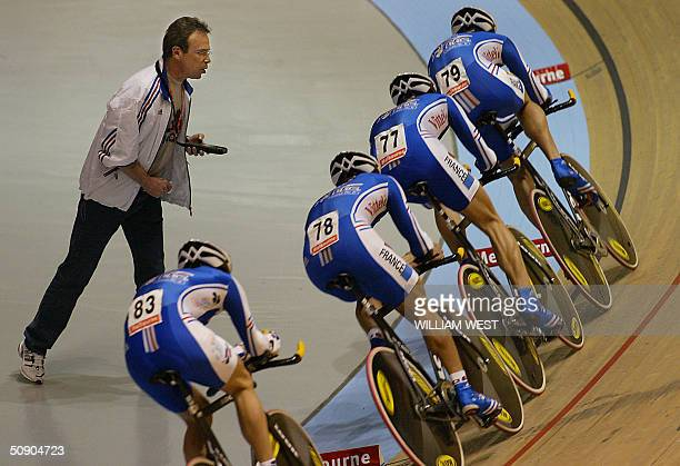 Coach Jacky Mourioux shouts times to the French team on their way to a shock defeat in the men's team pursuit qualifying session at the UCI Track...