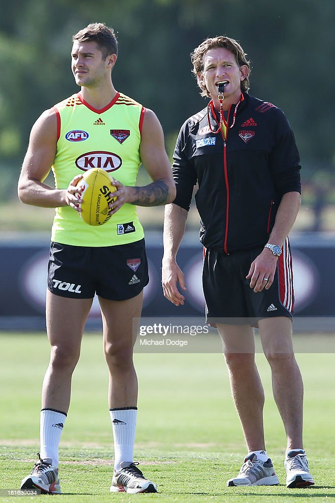 Coach James Hird blows his whistle next to Tayte Pears during a Essendon Bombers AFL training session at Windy Hill on February 14, 2013 in Melbourne, Australia.
