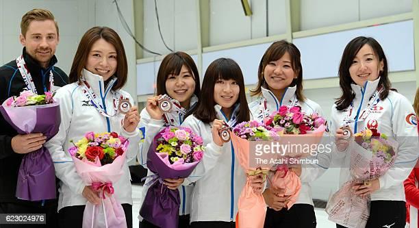 Coach James Lind, Mari Motohashi, Yurika Yoshida, Yumi Suzuki, Chinami Yoshida and Satsuki Fujisawa celebrate winning the bronze medals after beating...