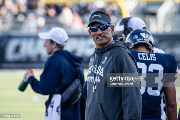 Coach Jay Norvell of the Nevada Wolf Pack watches the screen for a replay during the game against the San Jose State Spartans at Mackay Stadium on...
