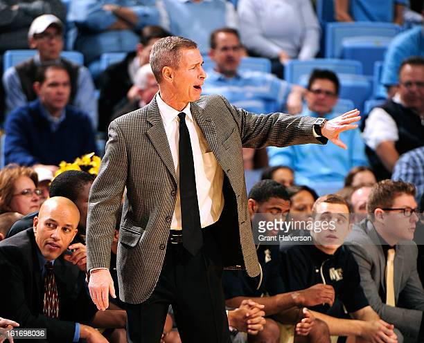 Coach Jeff Bzdelik of the Wake Forest Demon Deacons directs his team against the North Carolina Tar Heels during play at the Dean Smith Center on...