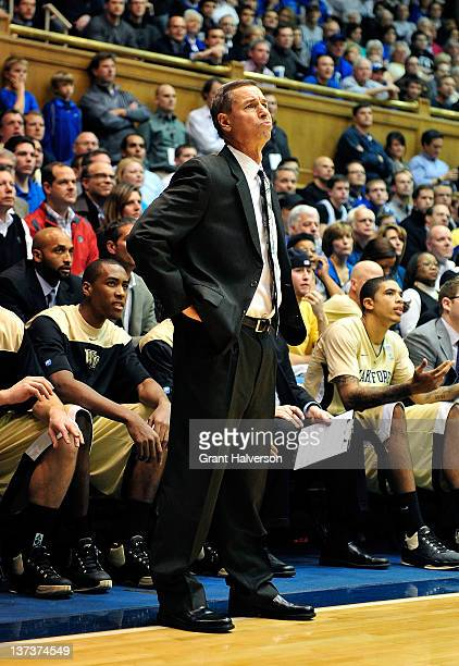 Coach Jeff Bzdelik of the Wake Forest Demon Deacons looks up at the scoreboard during a loss to the Duke Blue Devils at Cameron Indoor Stadium on...