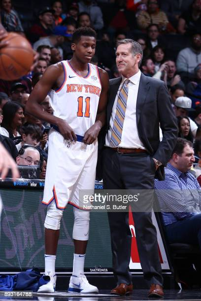 Coach Jeff Hornacek of the New York Knicks speaks with Frank Ntilikina as they play against the Brooklyn Nets on December 14 2017 at Barclays Center...