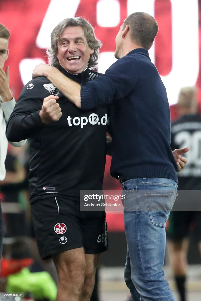 Coach Jeff Strasser and Gerry Ehrmann of 1.FC Kaiserslautern celebrate during the Second Bundesliga match between 1. FC Kaiserslautern and SpVgg Greuther Fuerth at Fritz-Walter-Stadion on September 29, 2017 in Kaiserslautern, Germany.